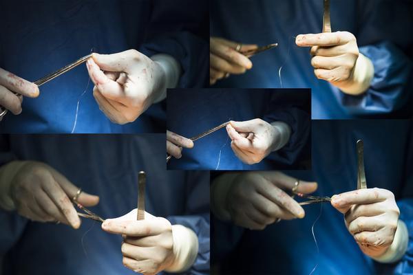 Врач с медицинскими нитками